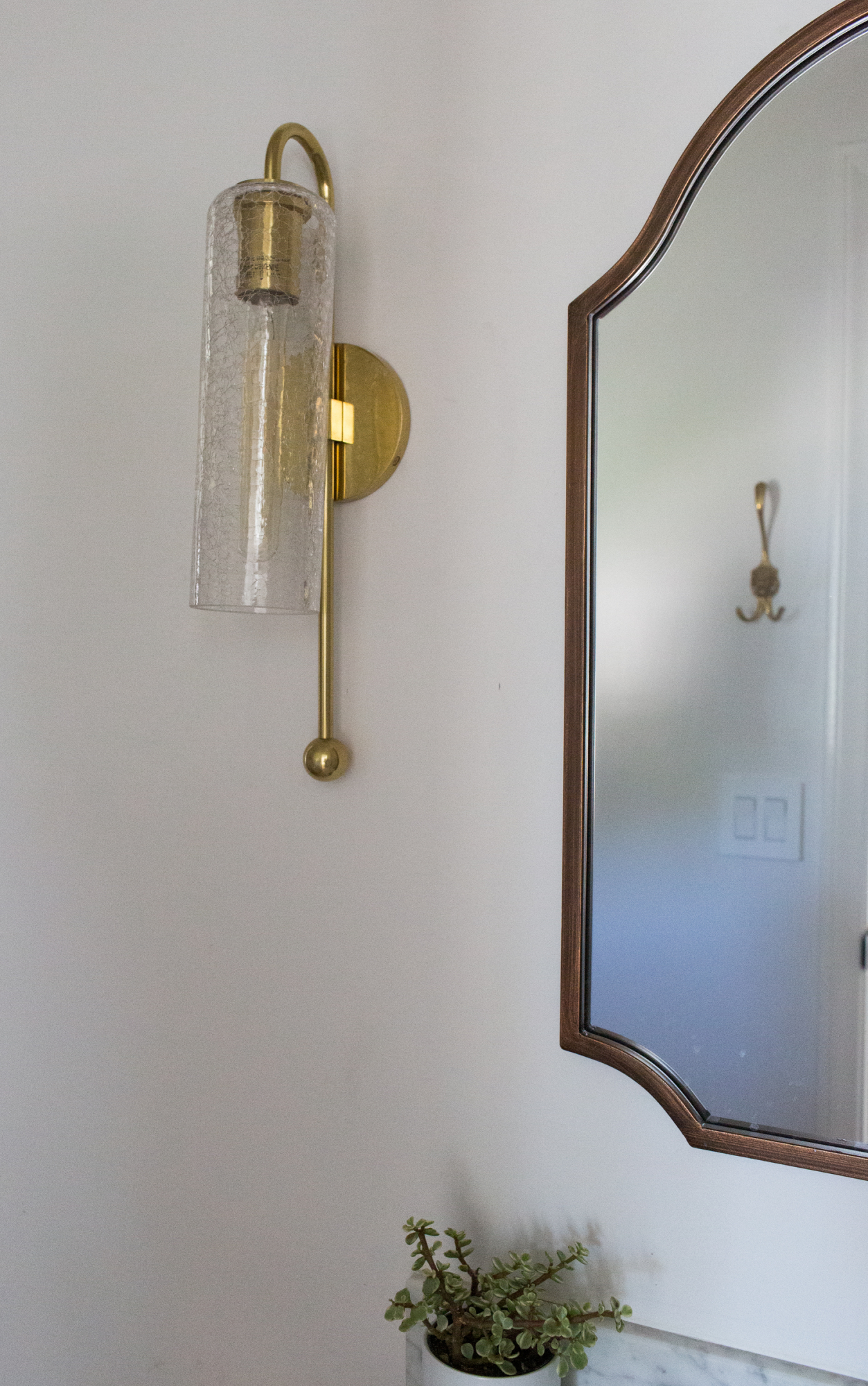 Aged brass wall sconce from Lamps Plus